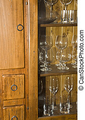 Retro wooden sideboard with glasses