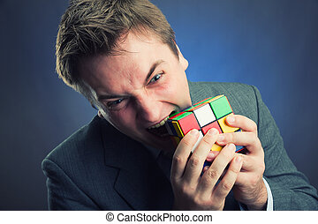 Businessman holding rubik cube in his hands - Businessman...