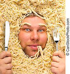 Man's face in pasta, closeup - Man's face in pasta, dinner...