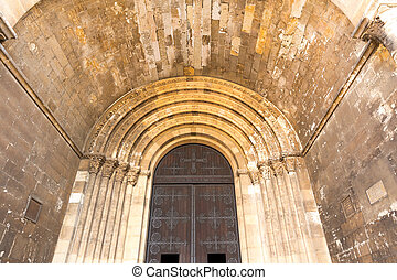 Old building - Arch ceiling of old building with iron doors,...