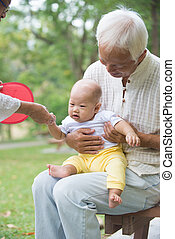 asian grandfather playing with grandkid