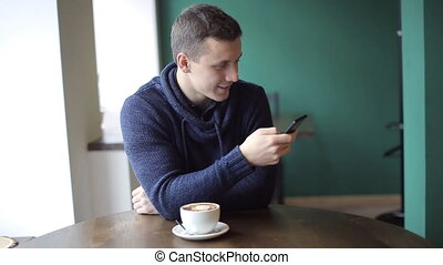 Handsome Man whith Smartphone in cafe - Handsome Man whith...