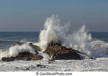 Splashing waves against rocks from the northern portuguese...