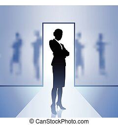 Businesswoman executive in focus on blurry background -...