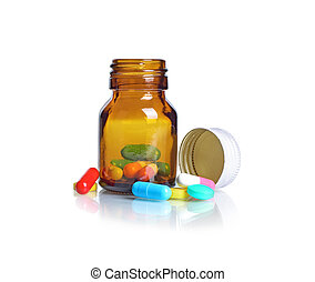 Pill bottle Pills spilling out of pill bottle isolated on...