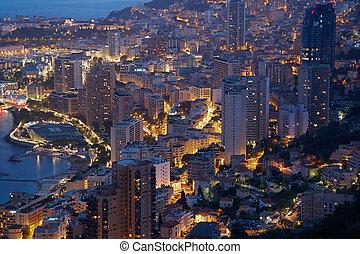 Monte Carlo, illuminated city view in the evening, Monaco,...