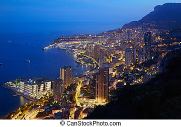 Monte Carlo, illuminated city view in the evening, Monaco,...