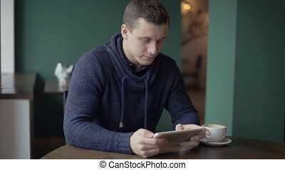 man using tablet computer touchscreen in cafe 1920x1080