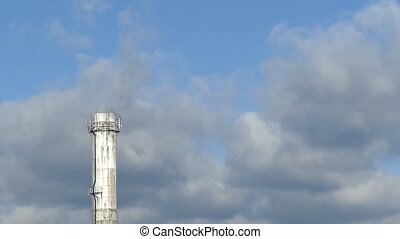 white pipe plant close up smoke black blue sky against...