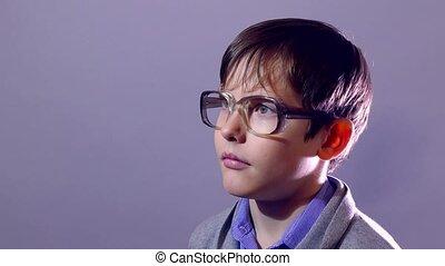 boy teenager portrait schoolboy nerd glasses on purple...