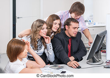 Business team of five planning work in office