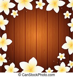 Spa background with frangipani flowers on wooden planks...