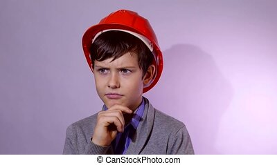 Teen boy builder in orange helmet I think problem studio...