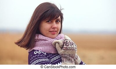 girl woman portrait in sweater scarf and mittens on the...