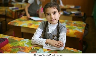teen girl schoolgirl sitting at a desk in a classroom school...