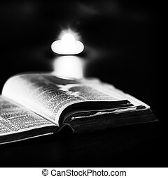 Bible with candles in the background. Low light high...