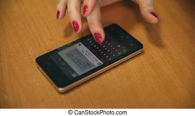woman phone writing sms on smartphone on table close up -...