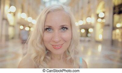 Happy girl full of emotions makes selfie in Milan - Happy...
