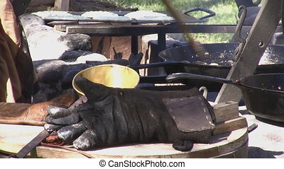 Outdoor Cooking - Cooking outdoors over an open fire