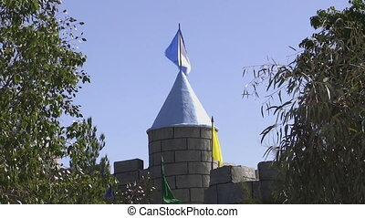 Castle Flags - Flags of a castle battlement blowing in the...