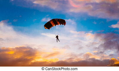 Skydiver On Colorful Parachute In Sunny Sunset Sunrise Sky....