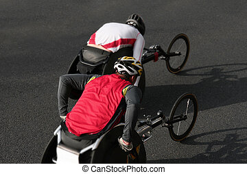 wheelchair athletes - two athletes racing a marathon on...