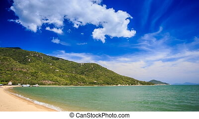 cumulus cloud motion over hilly island beach azure sea -...