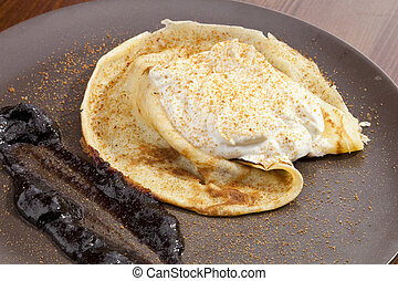 Crepe pancake with whipped cram and gingerbread powder