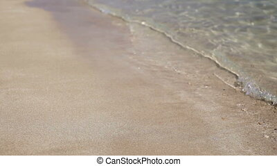 Sea water washes up a sandy shore and out again FullHD video...