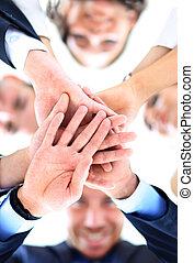 Small group of business people joining hands, low angle view