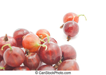 heap of red gooseberries on white background