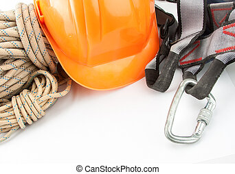 New climbing equipment of carabiner, orange helmet and rope