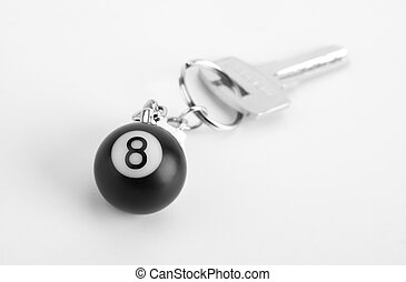 Small 8-ball on key ring - Close-up of small 8-ball on key...