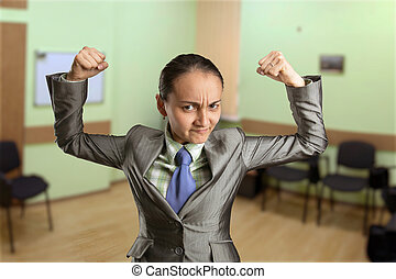 Strong woman in the office - Strong woman with fists in the...