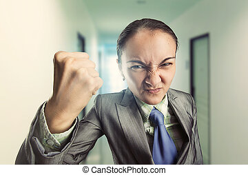 Angry irritated woman in the office - Angry irritated woman...