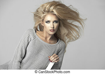 Beauty blond woman on chair