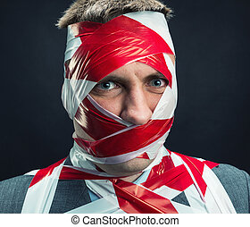 Man with stripped duct tape over body - Victum man with...