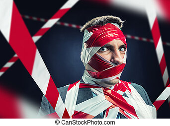 Man with stripped duct tape over body - Scared man with...
