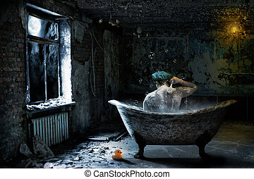 Alone man in abandoned bathroom - Alone sad man taking bath...