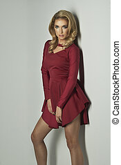 Sexy young beauty blonde woman in red dress