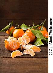 clementines - clementine over dark wooden background