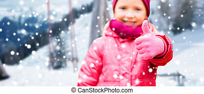 happy girl showing thumbs up over winter - winter holidays,...