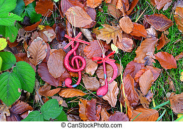 christmas music note in an autumn forest