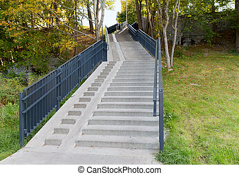 stair case with railings in autumn park - architecture...
