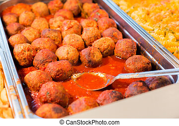 close up of meatballs and other dishes on tray - food,...
