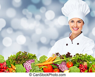Chef woman with vegetables - Beautiful Chef woman over...