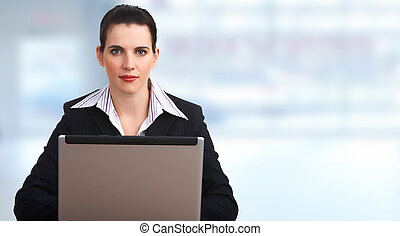 Beautiful business woman with laptop computer.
