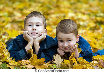 Autumn portrait of two brothers