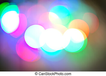 Background of defocussed color lights with sparkles -...