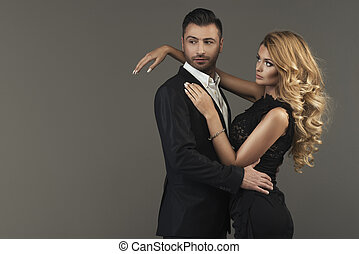 portrait of a young fashion couple looking into the camera